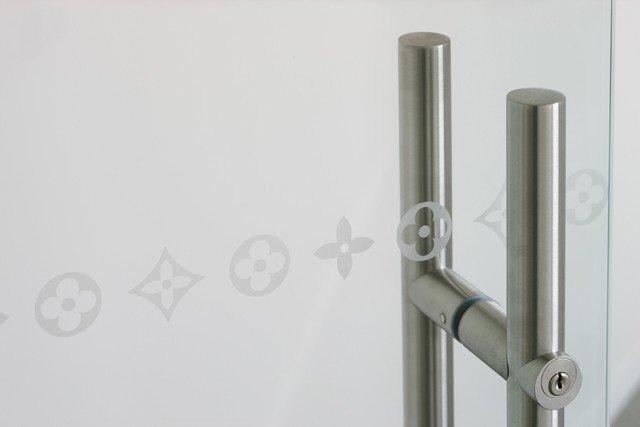 glass door with LV logo