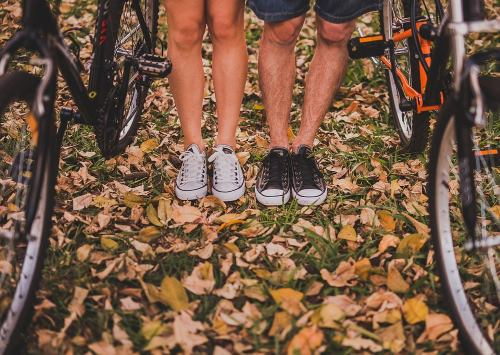 two people with bikes